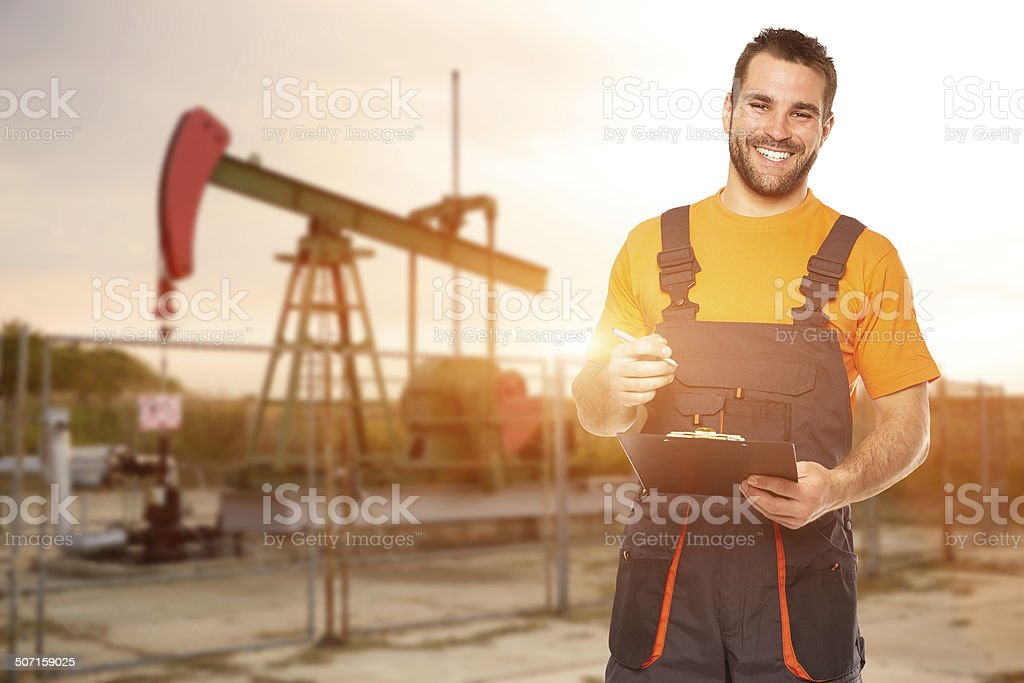 Refinery worker reads data from the black plates stock photo