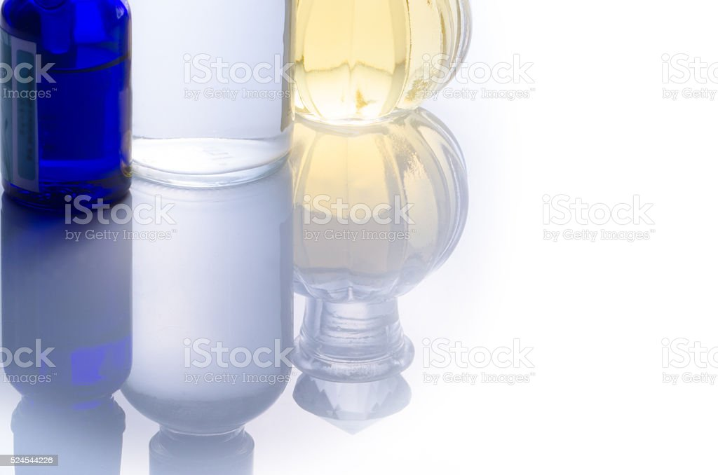 Reflected bottles with essential oils stock photo