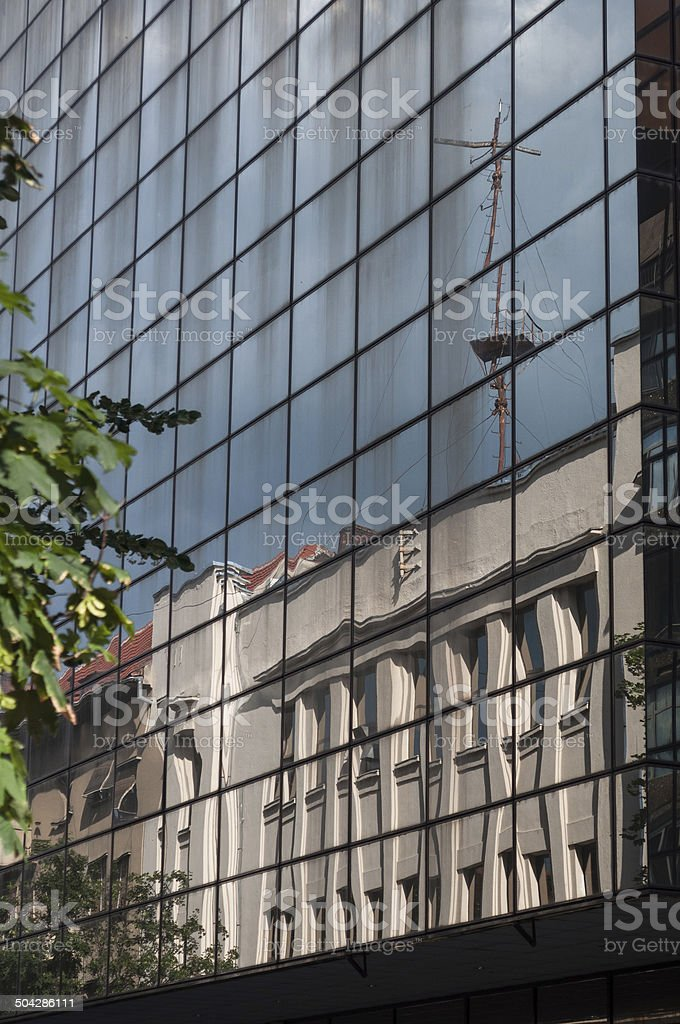 reflected crane on a building's windows royalty-free stock photo