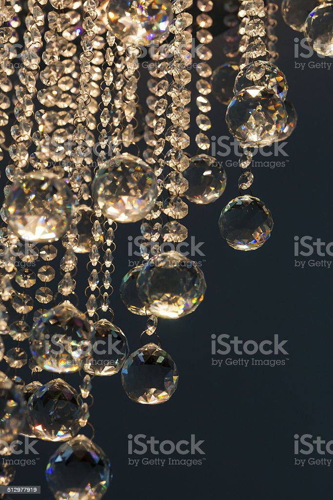 reflected crystal chandelier with lighting stock photo