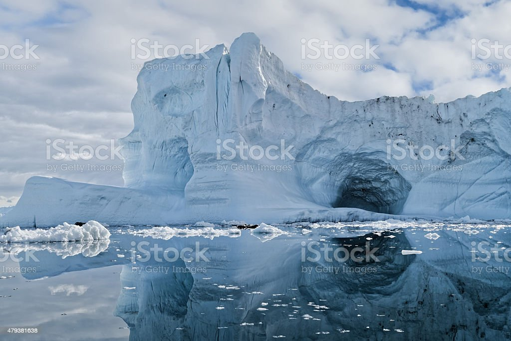 Reflected Iceberg with Cave Greenland Ilulissat stock photo