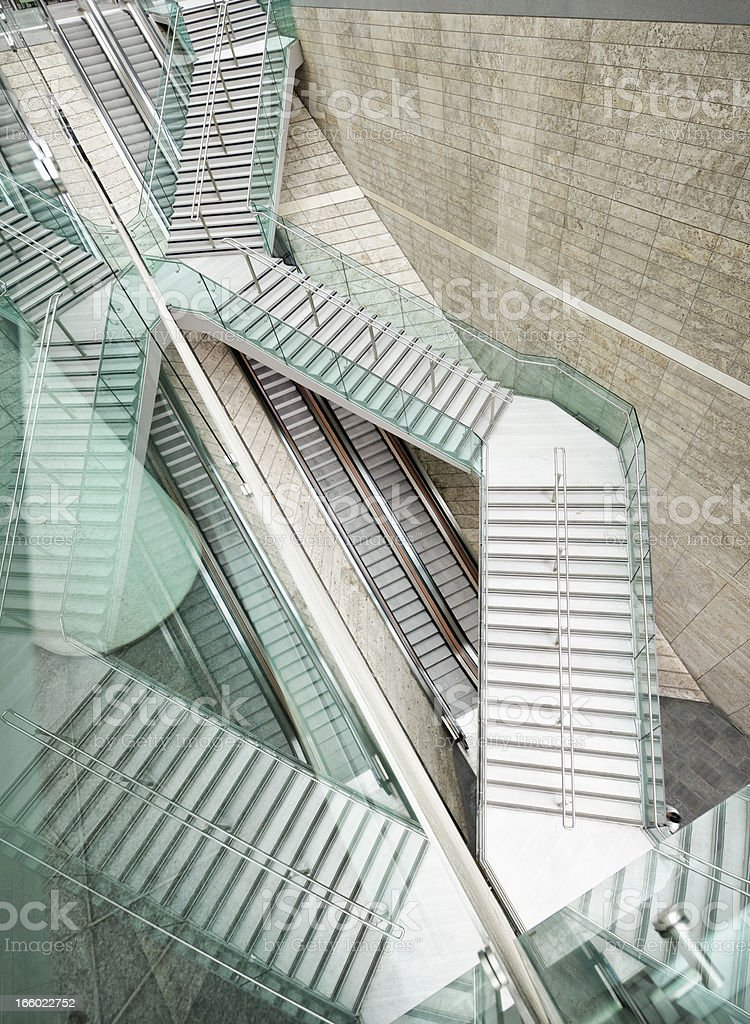 Reflected Modern Architecture - Winding Stairs over Straight Escalators stock photo