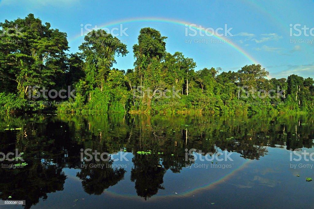 Reflected Rainbow - Peruvian Amazon. stock photo