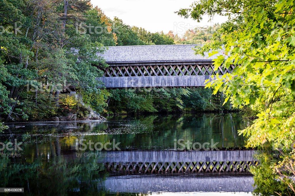 Reflecting Covered Bridge stock photo