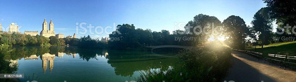 Reflecting lake and Bow bridge at Central Park stock photo