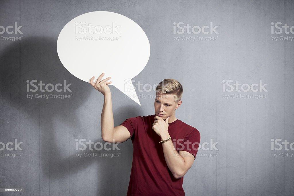 Reflecting man holding blank speech bubble. royalty-free stock photo