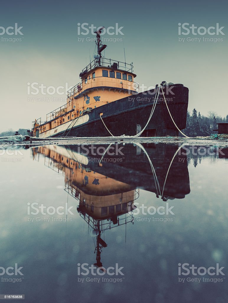 Reflecting Tugboat stock photo