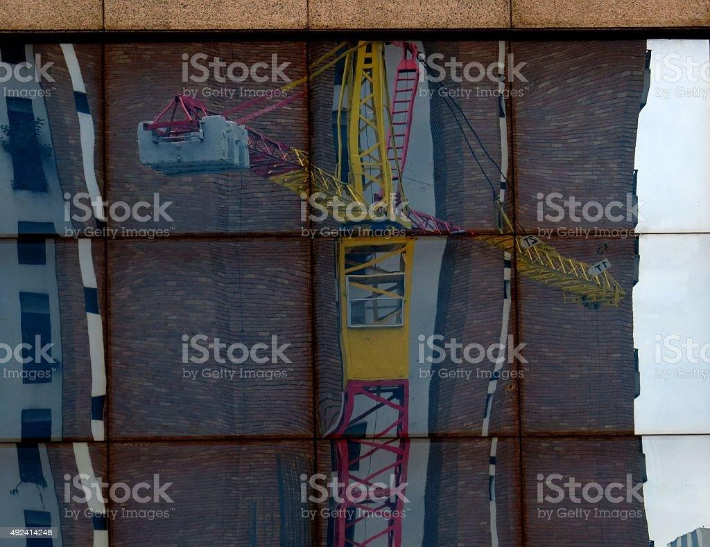 Reflection construction crane stock photo