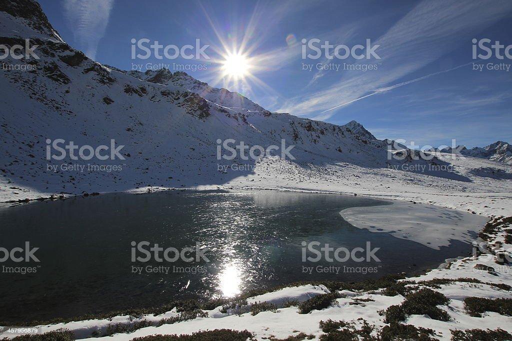 Reflection & First Snow in Autumn, Panorama Hirschebensee, Tyrol, Austria stock photo