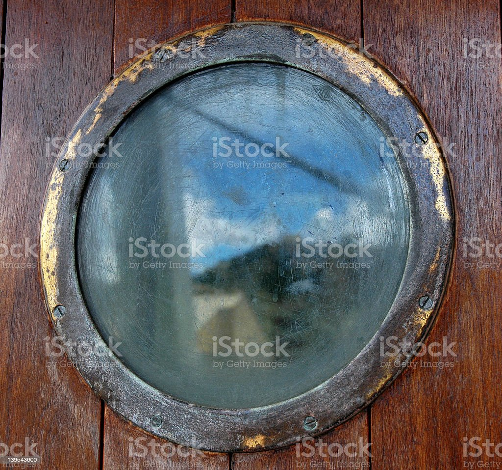 Reflection in a porthole royalty-free stock photo