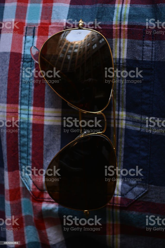 Reflection in mirrored sunglasses stock photo