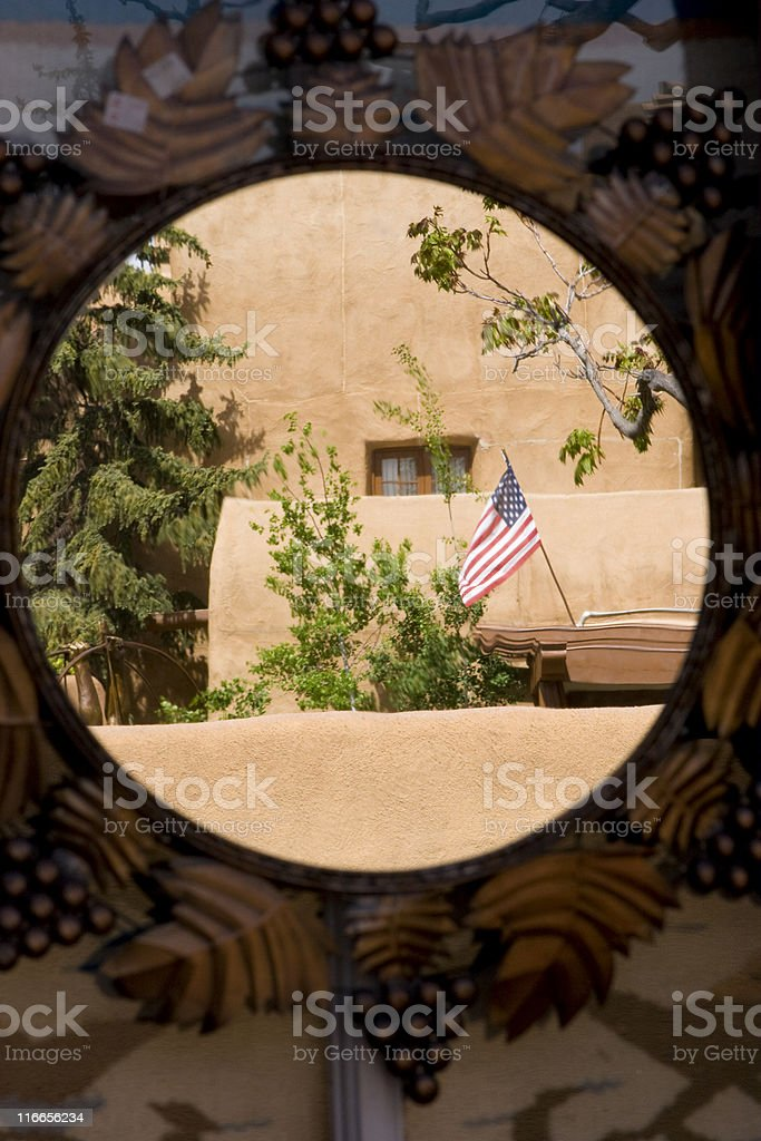 Reflection in Ornate Mirror, American Flag, Circle, Adobe Structure royalty-free stock photo