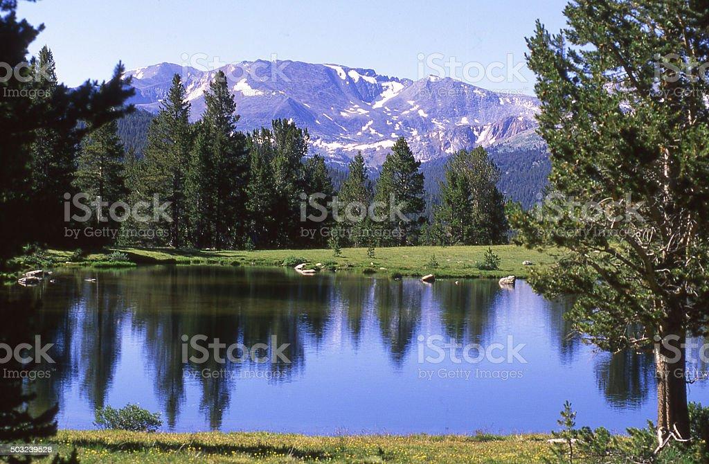 Reflection in small lake Sierra Nevada Mountains California stock photo