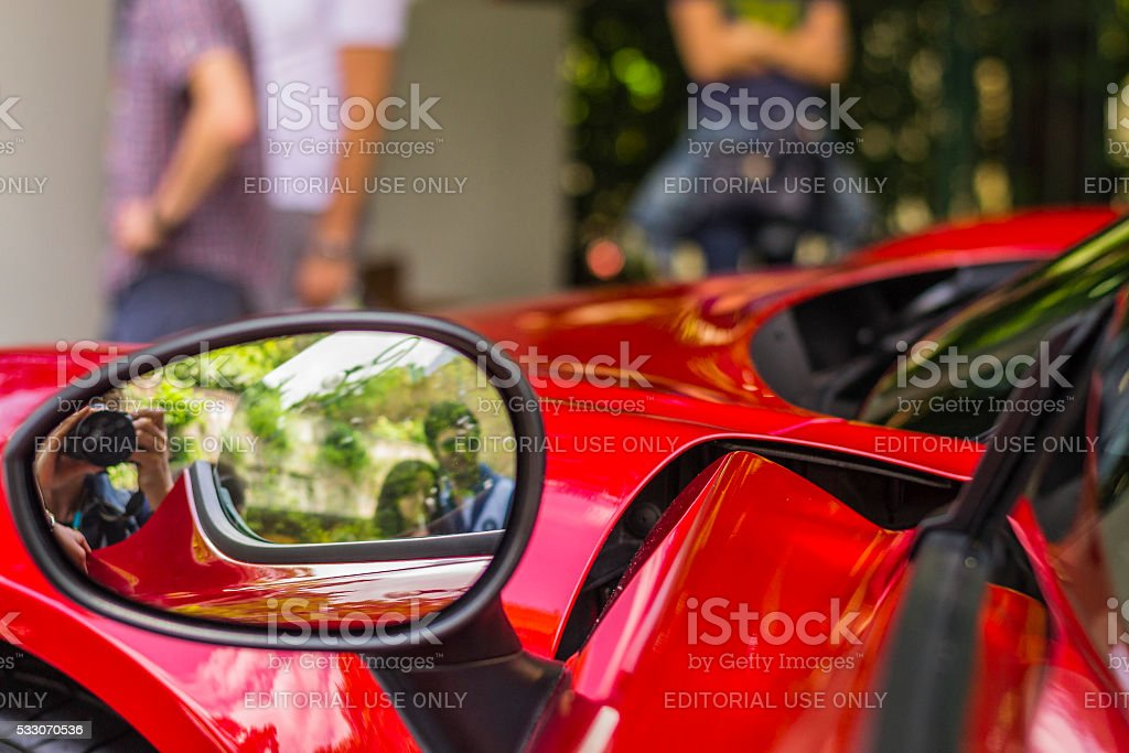 Reflection in the outside rearview mirror of a sports car stock photo