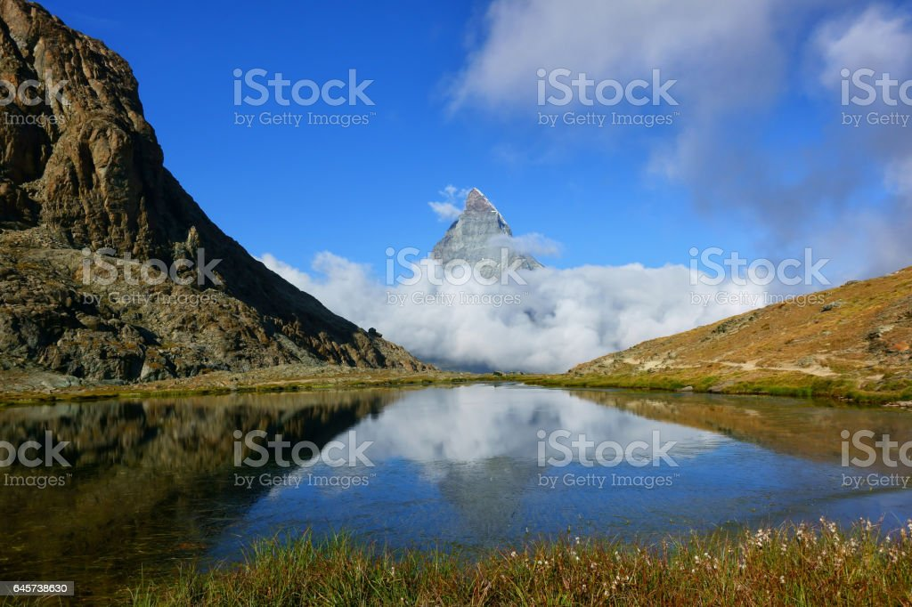 Reflection in the Riffelsee of Matterhorn and cloud under with lake during summer, Switzerland stock photo