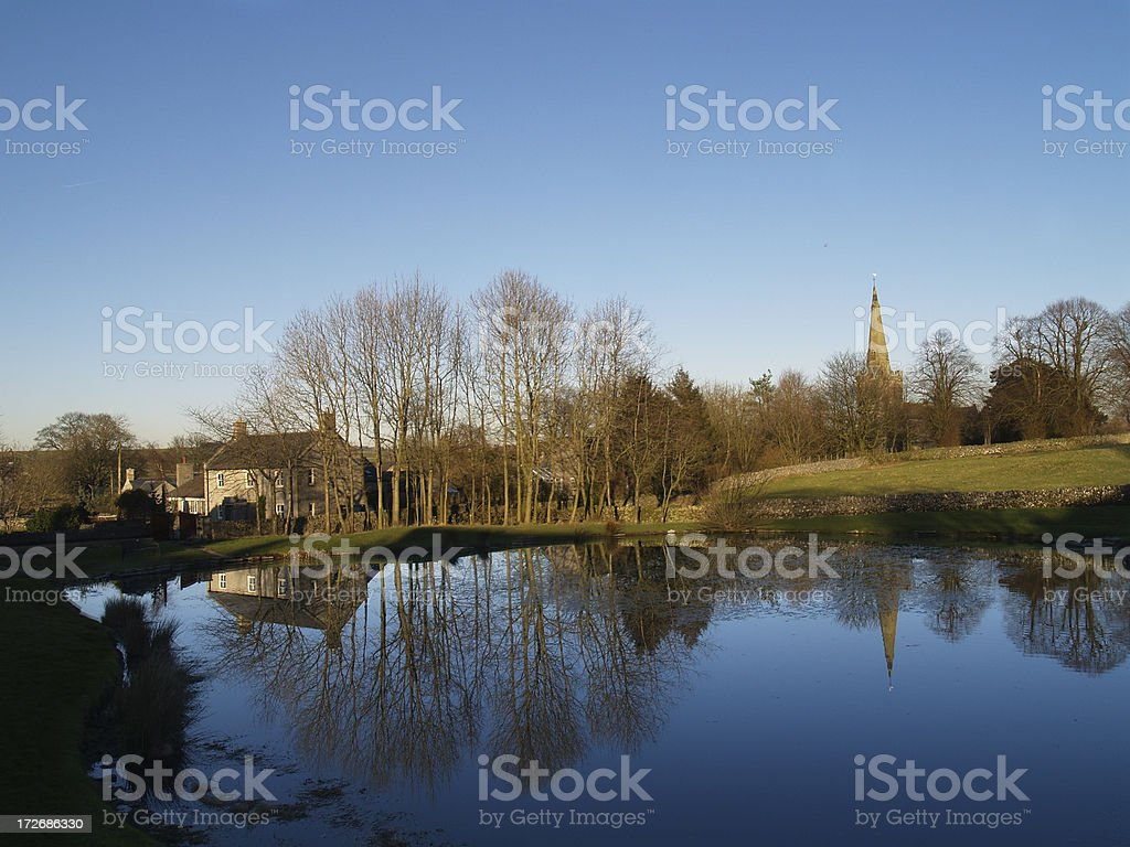 reflection in the village pond stock photo