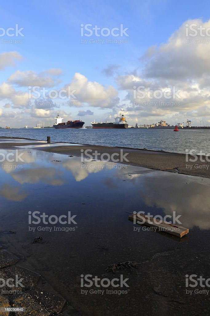 reflection of a cloudscape in the water stock photo