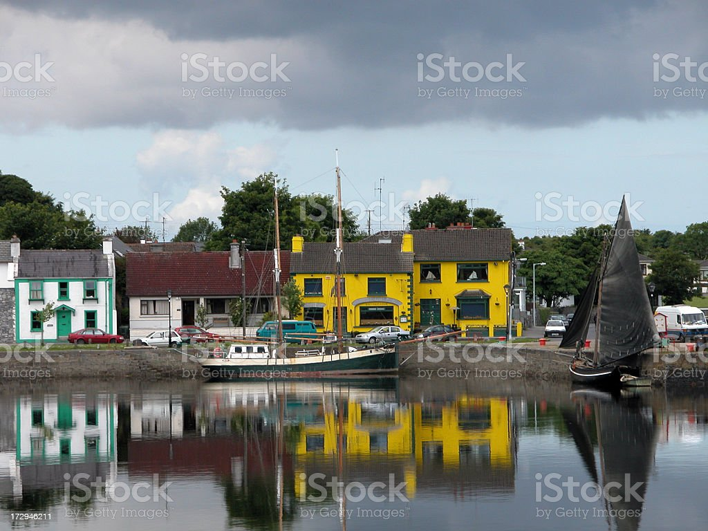 Reflection of a little town on a river stock photo