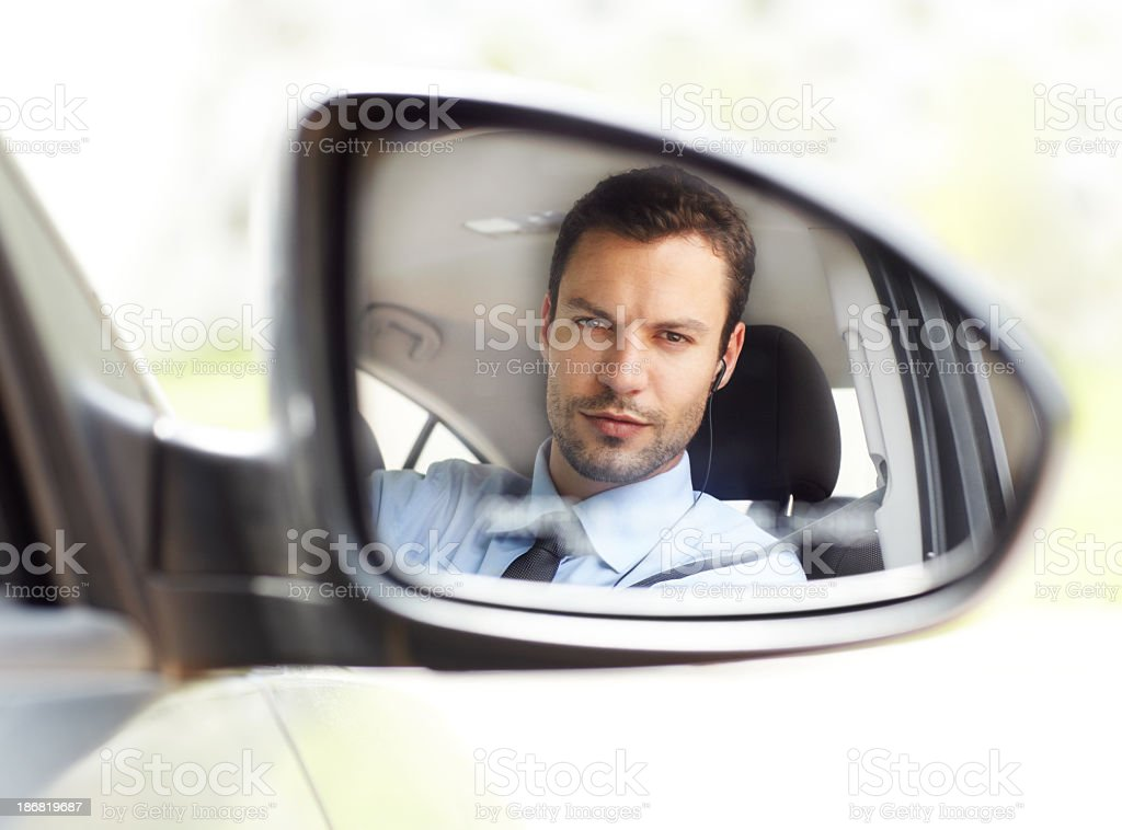 Reflection of a man in side car mirror stock photo