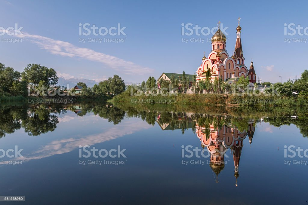 Reflection of a Russian orthodox church in water, in Almaty, Kazakhstan stock photo