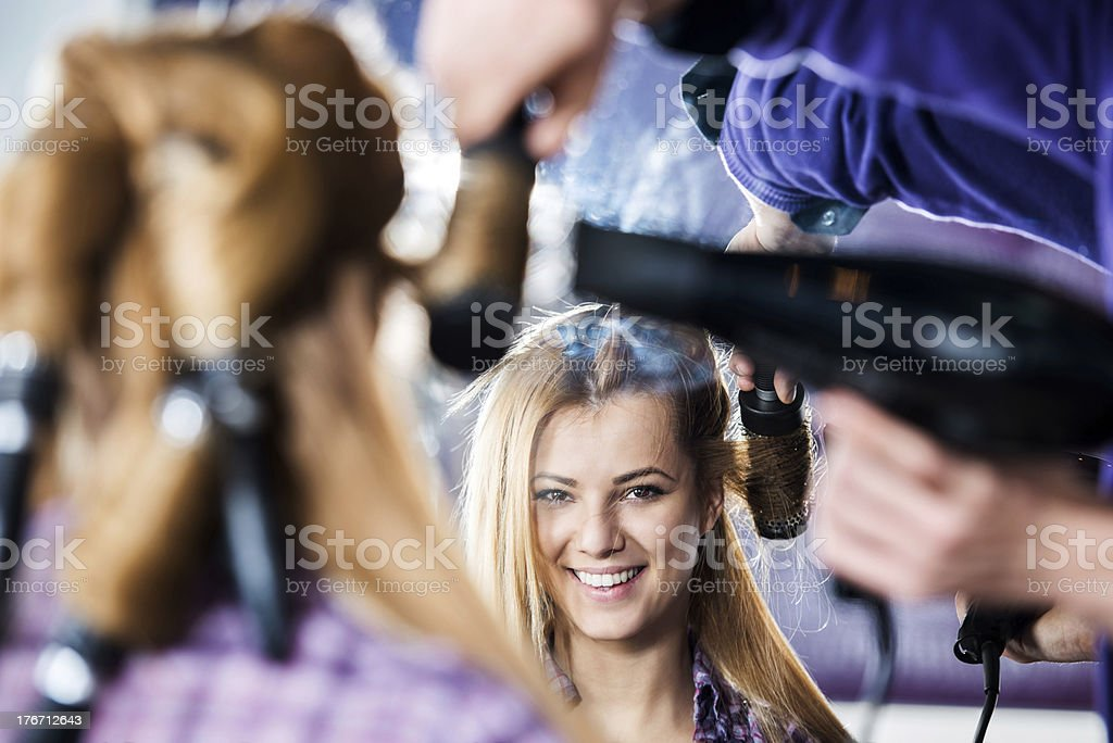 Reflection of a smiling woman. royalty-free stock photo