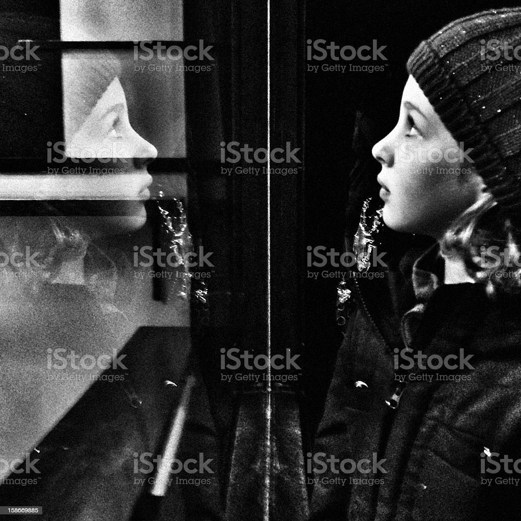 Reflection of a young girl in profile royalty-free stock photo