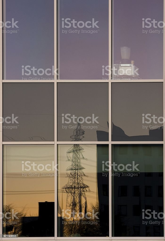 Reflection of an electricity pylon royalty-free stock photo