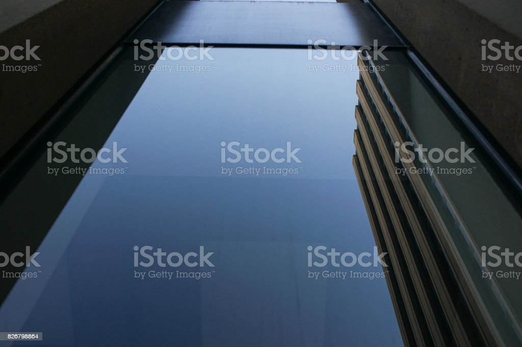reflection of architecture in a modern window stock photo