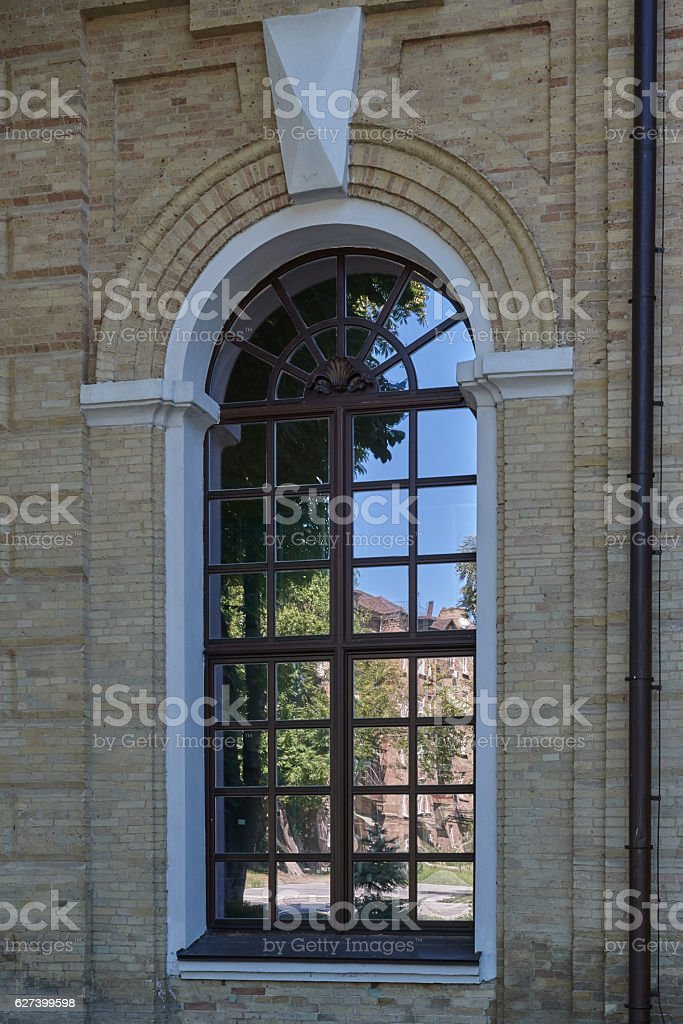 Reflection of blue sky and houses in a large window stock photo