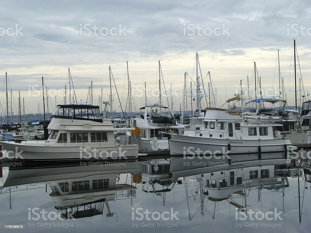 Reflection of boats in a calm harbor. royalty-free stock photo