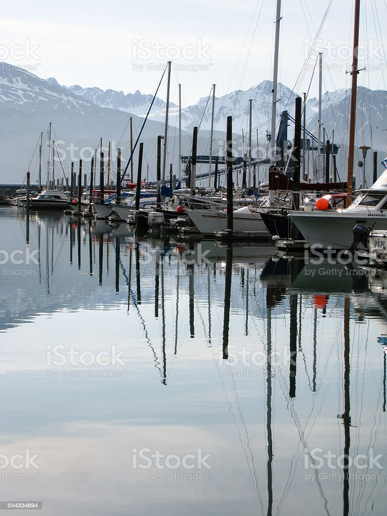 Reflection of Boats with mountain on background in Seward stock photo