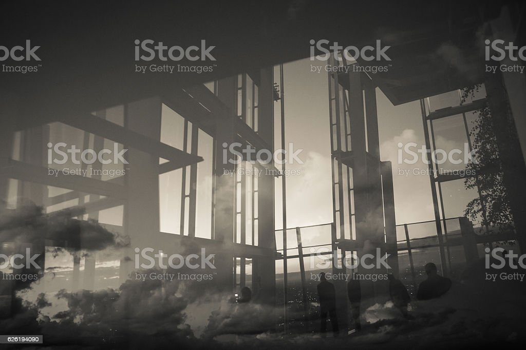 Reflection of building construction and people looking through windows stock photo