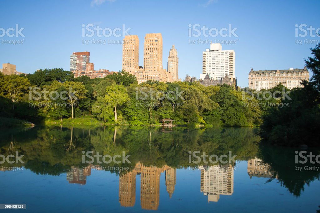 Reflection of buildings in the lake at Central Park stock photo