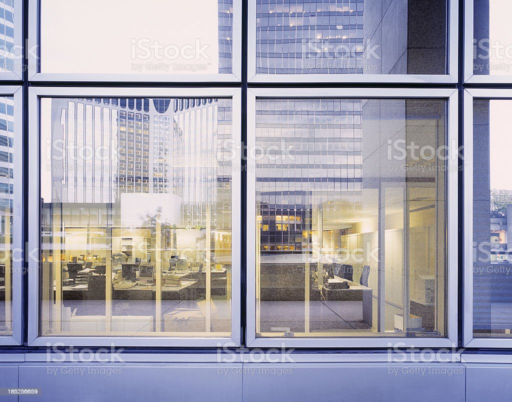 Reflection of business district in office window royalty-free stock photo