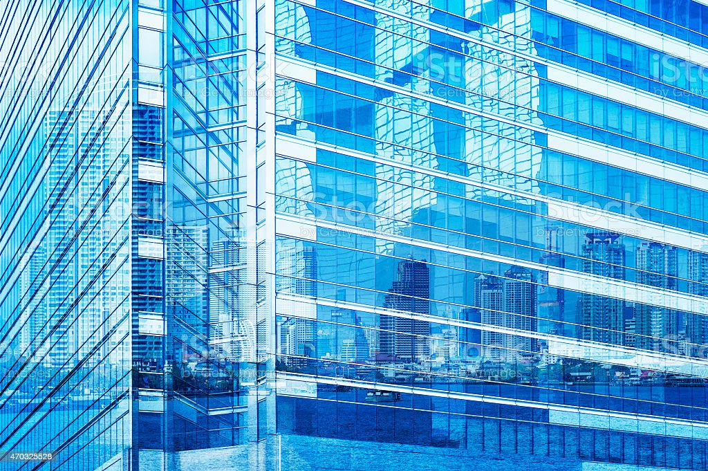 Reflection of city tower on modern window buildind stock photo