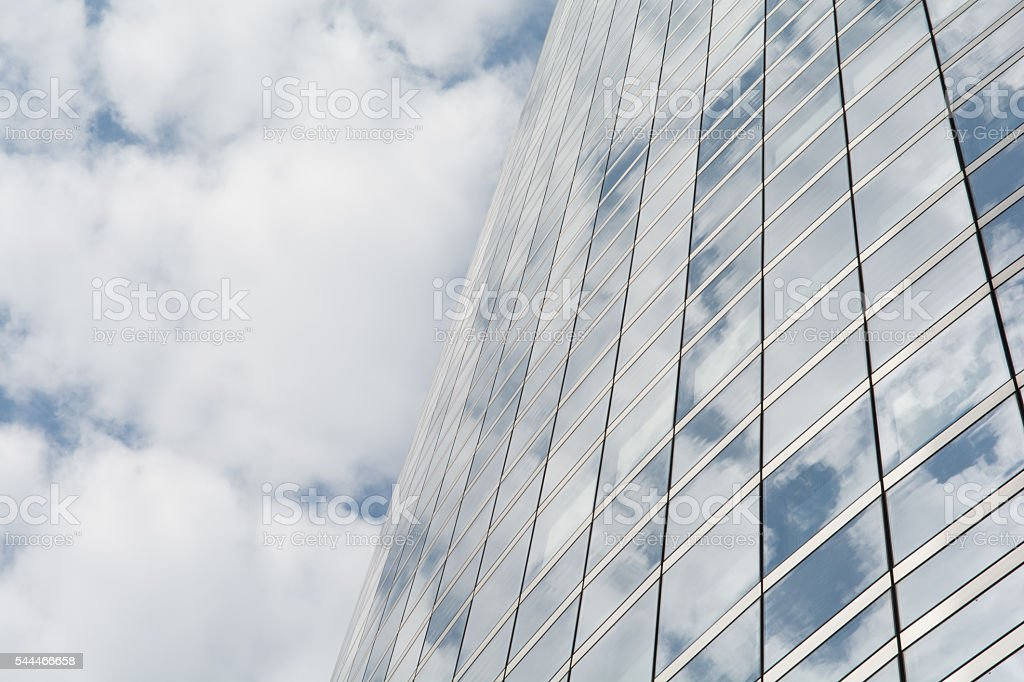 Reflection of clouds on a glass facade stock photo