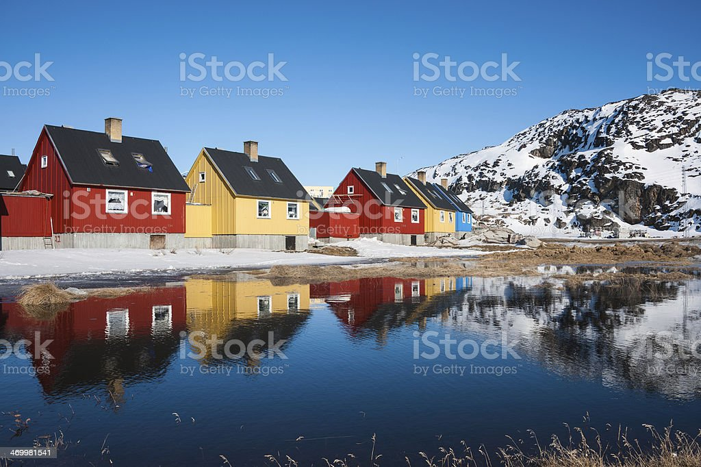 Reflection of colorful houses in Greenland. stock photo