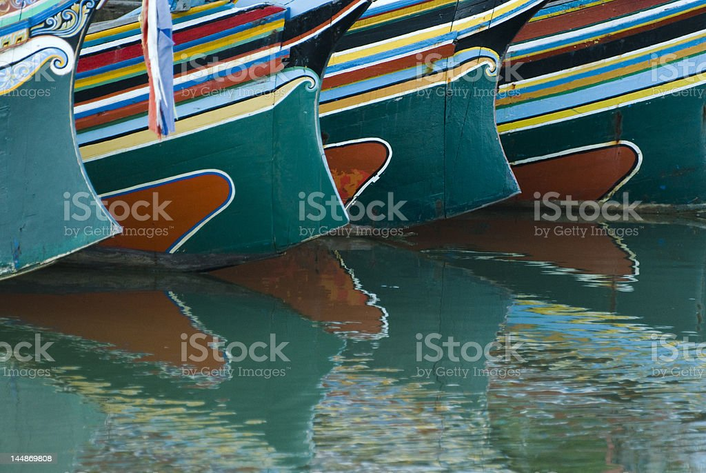 Reflection of colorful patterns on boats stock photo
