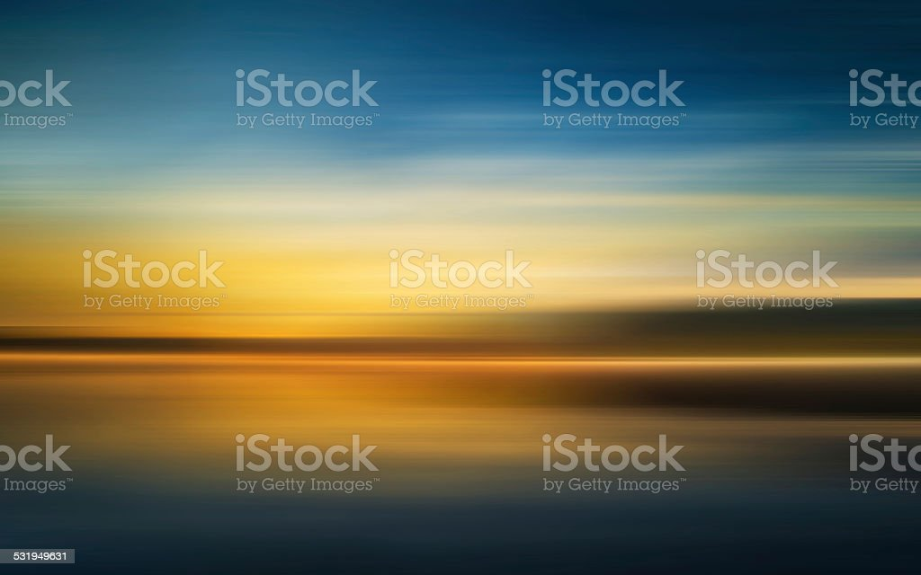 Reflection of Colorful sunset with long exposure effect, motion blurred stock photo