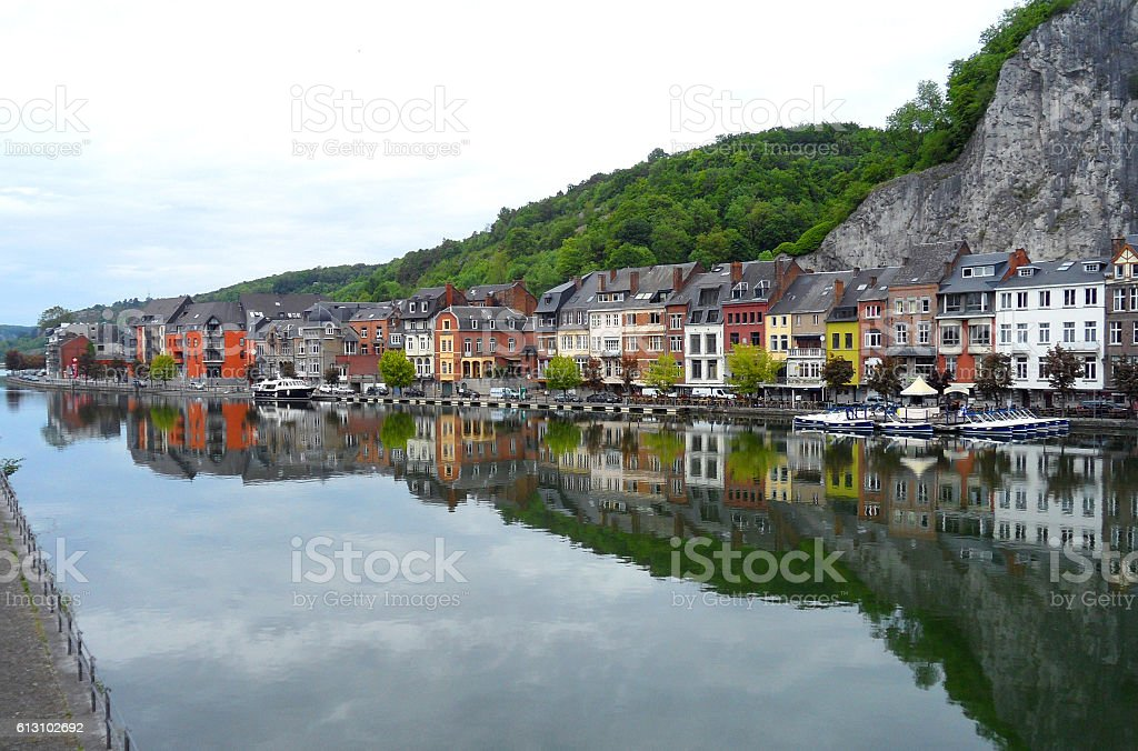 Reflection of Colorful Traditional Architectures on Meuse River, Dinant, Belgium stock photo