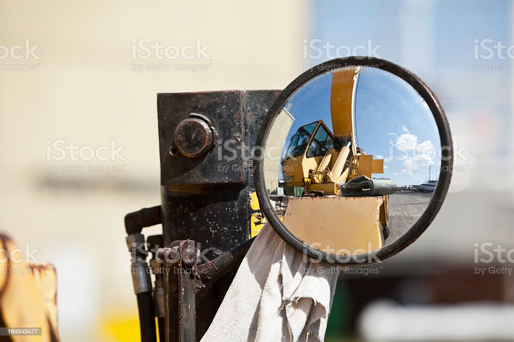 Reflection of crane in mirror stock photo