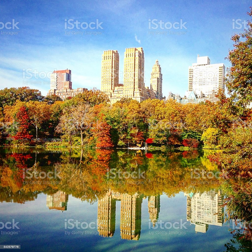 Reflection of Dakota Building in a lake in Central Park stock photo