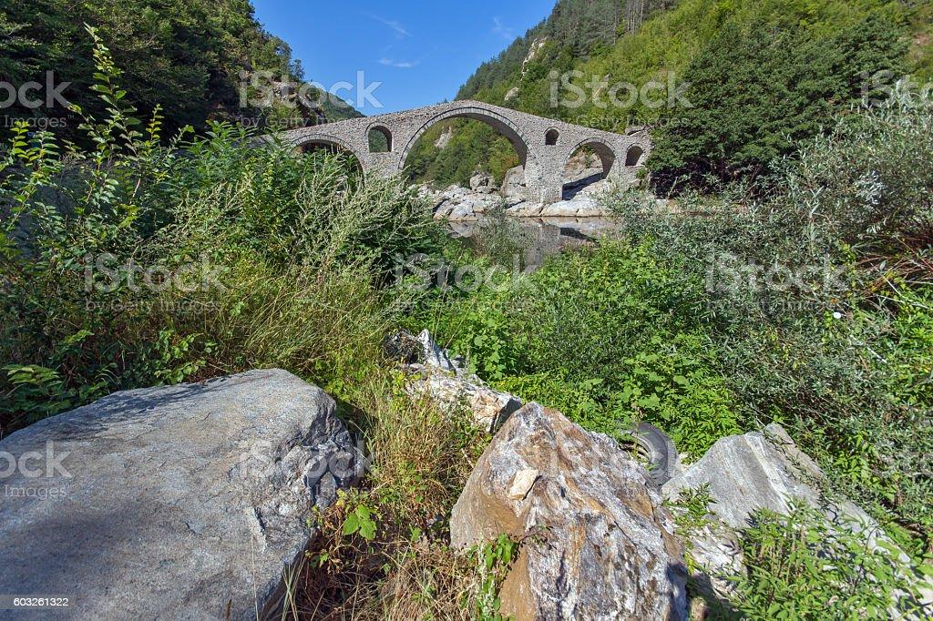 Reflection of Devil's Bridge in Arda river and Rhodopes mountain stock photo