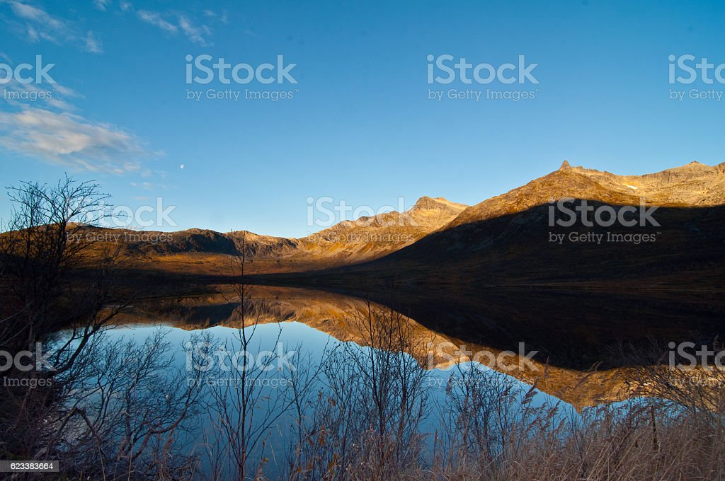 Reflection of Fjord in Norway stock photo