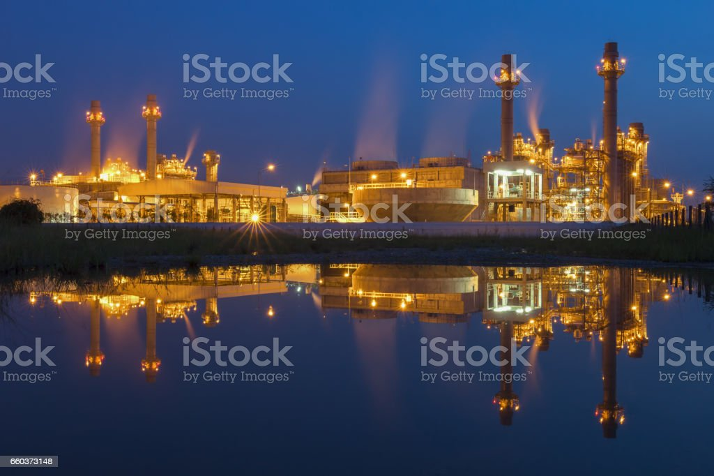 Reflection of Gas turbine power plant with blue hour stock photo