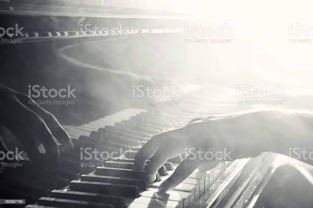 Reflection of hand playing the piano stock photo