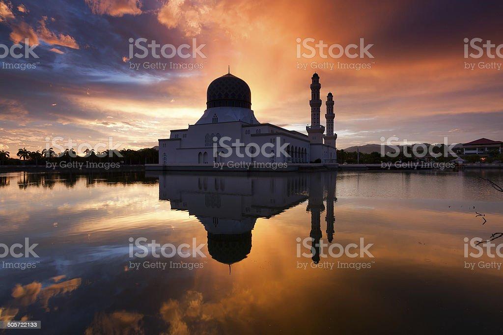 Reflection of Kota Kinabalu city mosque at sunrise stock photo