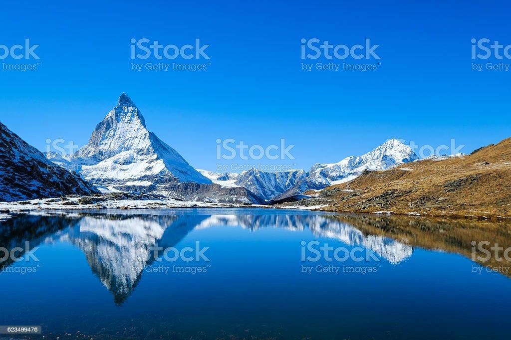 Reflection of Matterhorn in lake during autumn,zermatt, Switzerland stock photo