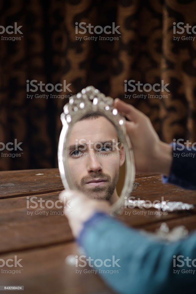 reflection of men in mirror stock photo