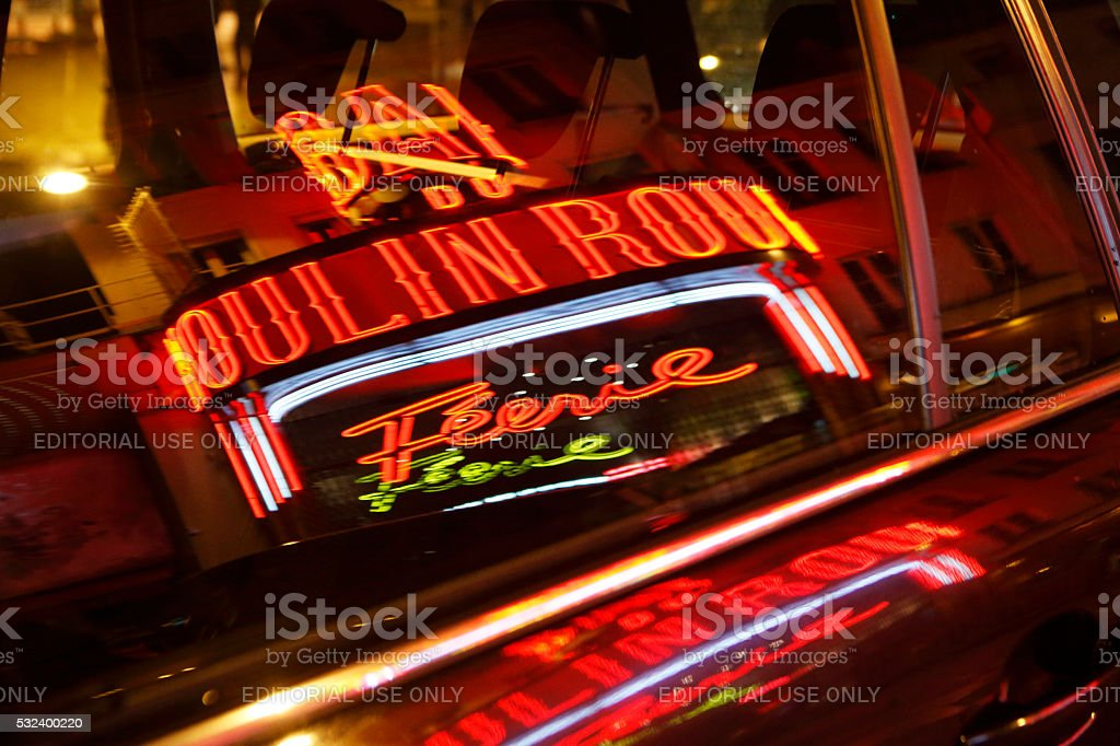 Reflection of Moulin Rouge in car window stock photo